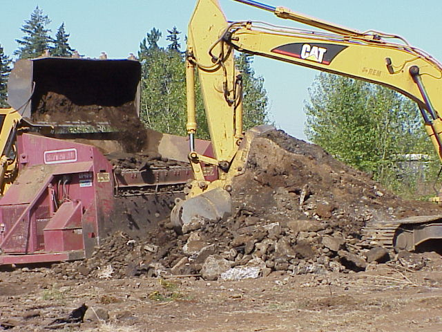 Photo of bulldozer at landfill