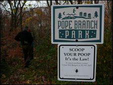image of a Pope Branch Park sign and a scoop your poop sign
