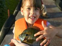 Photo of child holding fish