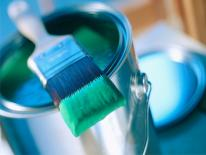 photo of bucket of paint and paint brush
