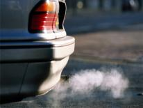 Photo of emissions from automobile tailpipe.